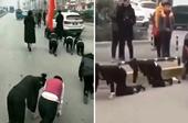 Công ty Trung Quốc phạt nhân viên bò trên đường vì không đạt chỉ tiêu