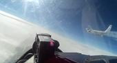 Giật mình xem Su-27 Nga truy đuổi máy bay gián điệp Mỹ trên biển