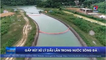Gấp rút xử lý dầu lẫn trong nước sông Đà