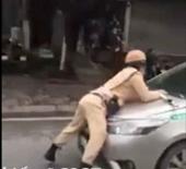 Tài xế taxi hất Trung uý CSGT lên nắp ca pô